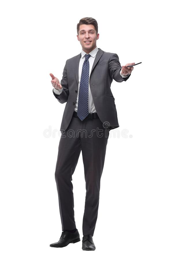 Friendly successful businessman with a smartphone . isolated on grey background stock photography