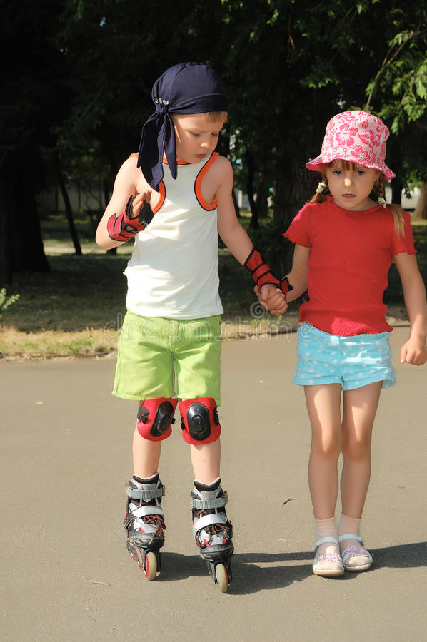 Friendly support. Rollerblading. royalty free stock photo