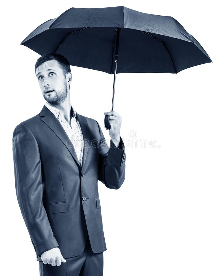 Surprised businessman holding an umbrella. royalty free stock images