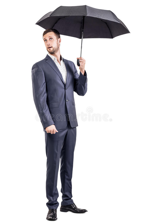 Surprised businessman holding an umbrella. royalty free stock photography