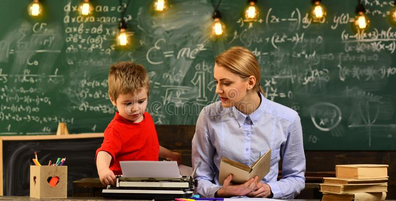 Friendly teacher and adult smiling student in classroom, Good teachers seek engaged students, Digital education online. Studying internet school concept royalty free stock photography