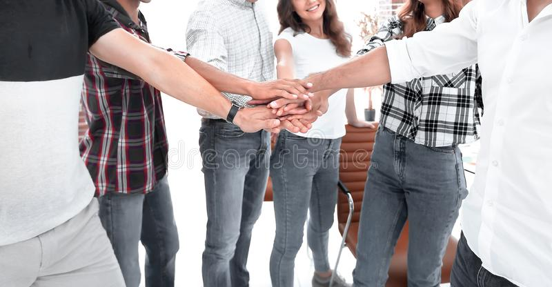 .friendly team of designers clasped their palms together royalty free stock image
