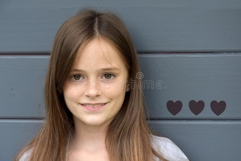 Friendly teenage girl stock images