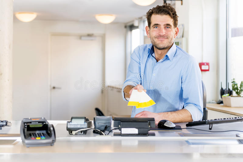 Friendly Ticket sales clerk royalty free stock images