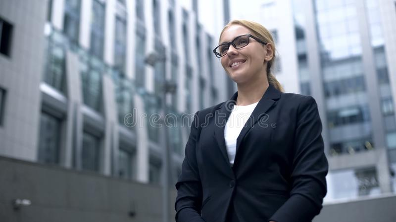 Friendly woman in suit meets foreign business partners, interpreter or hostess. Stock photo royalty free stock photos