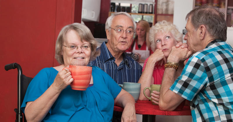 Friendly Woman in Wheelchair with Friends royalty free stock images