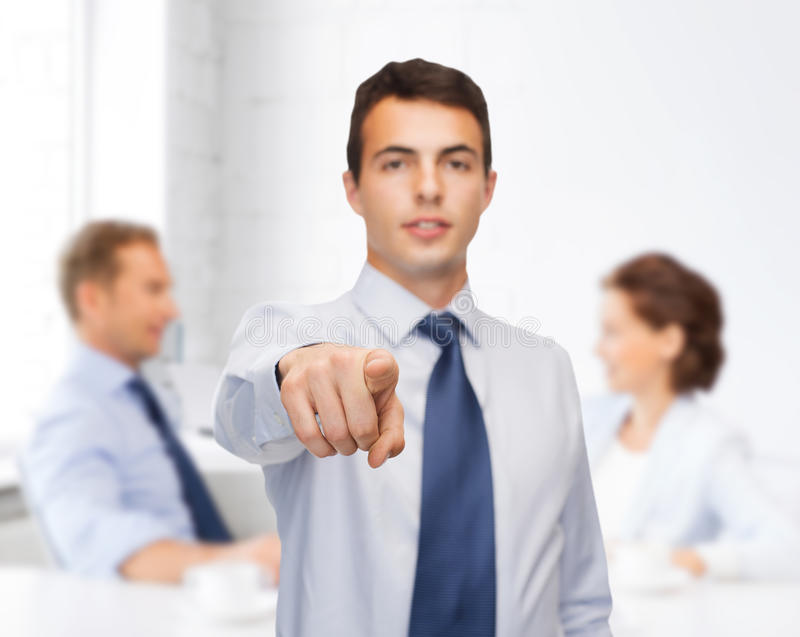 Download Friendly Young Buisnessman Pointing Finger Stock Image - Image: 38573617