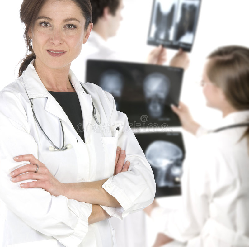 Friendly young doctors smiling over a white backgr royalty free stock photo