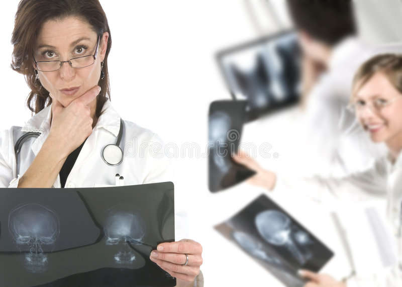 Friendly young doctors smiling over a white backgr royalty free stock photos
