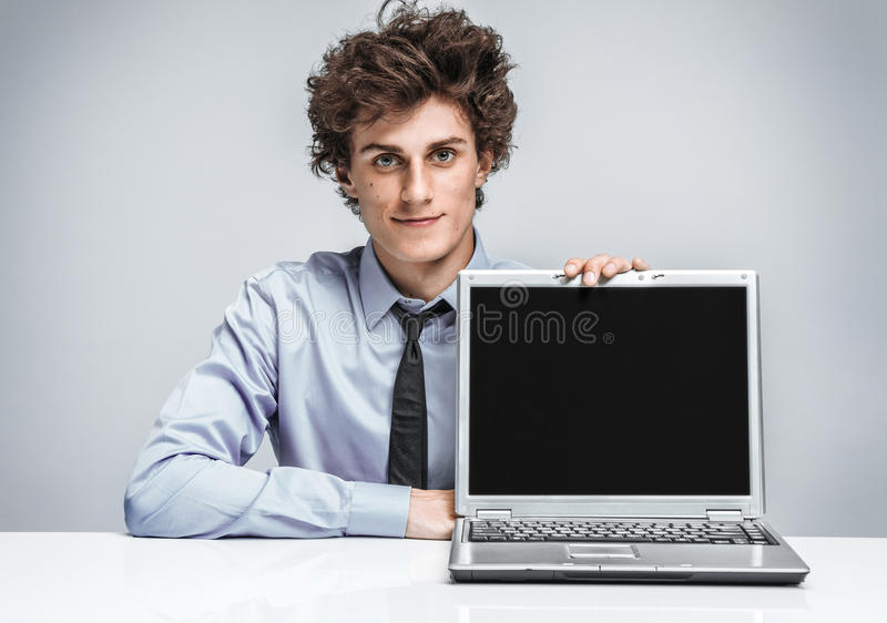 Friendly young manager is glad to see the client. royalty free stock photography