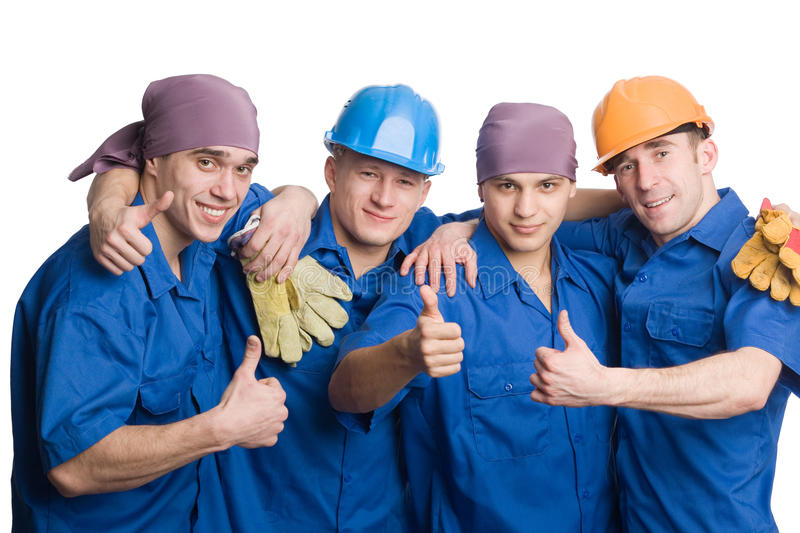 Friendly young team of construction workers stock photo