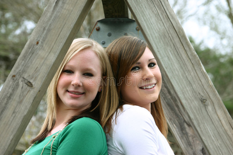 Friends. Two girls friends posing inside a-frame royalty free stock photography