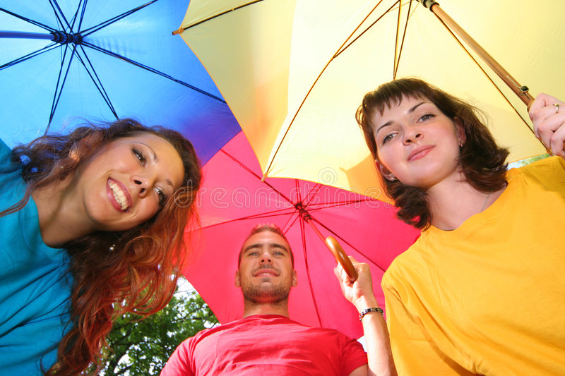 Friends. Funny colorful friends with umbrellas royalty free stock photography