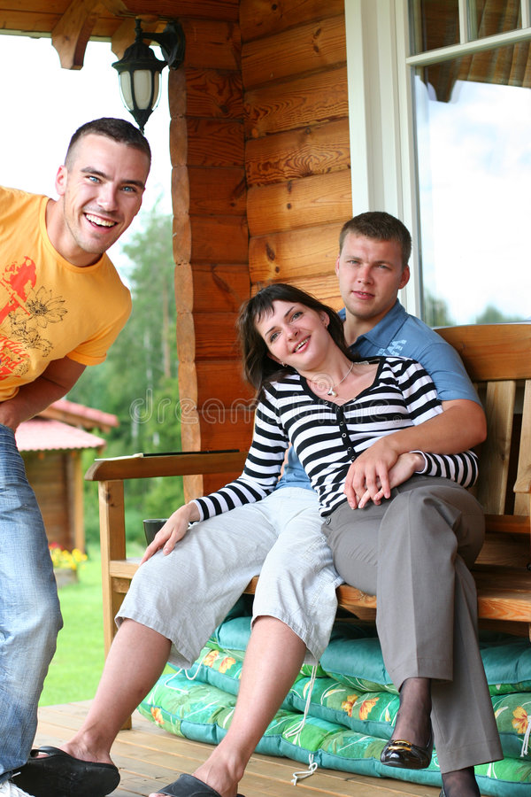 Friends. Funny friends relaxing in summer cottage royalty free stock image
