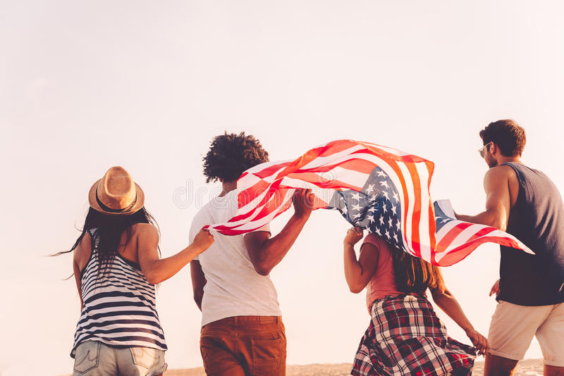 Friends with American flag. stock images