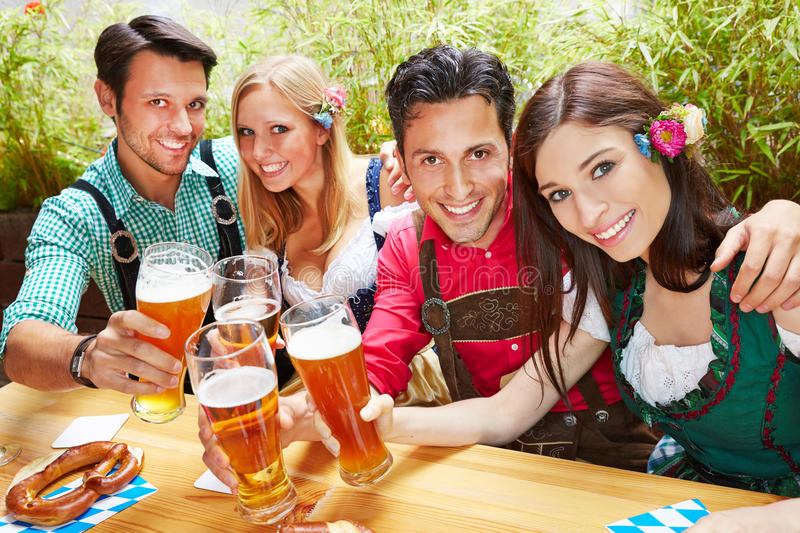 Friends in bavaria clinking beer stock image