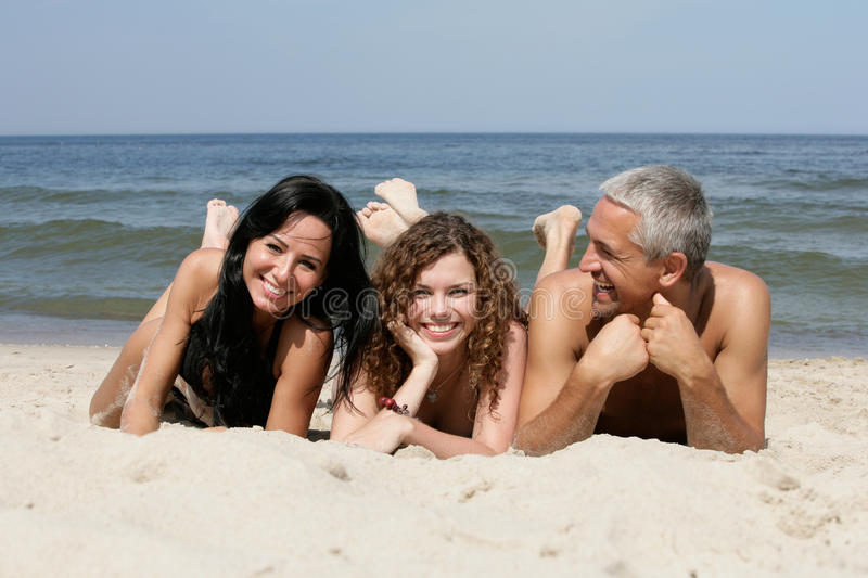 Friends on the beach stock image
