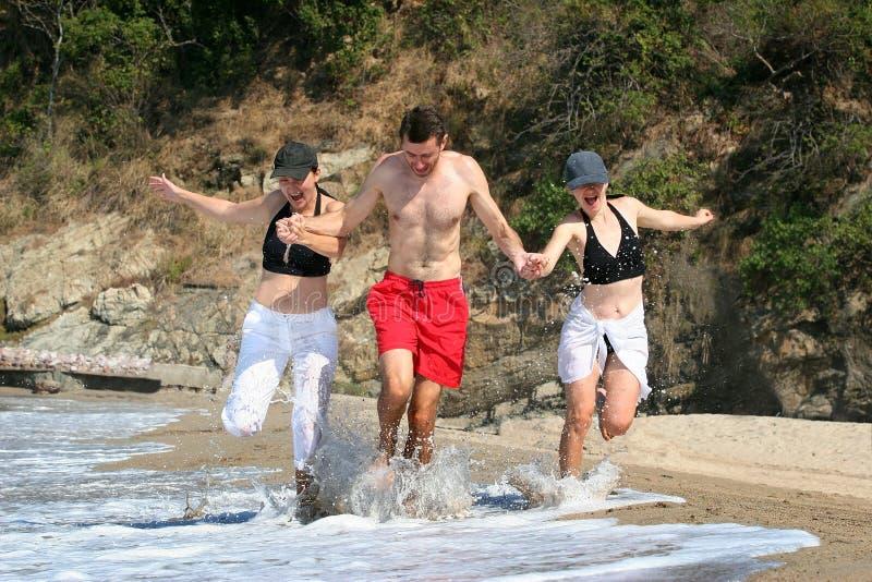 Friends on the beach royalty free stock photos