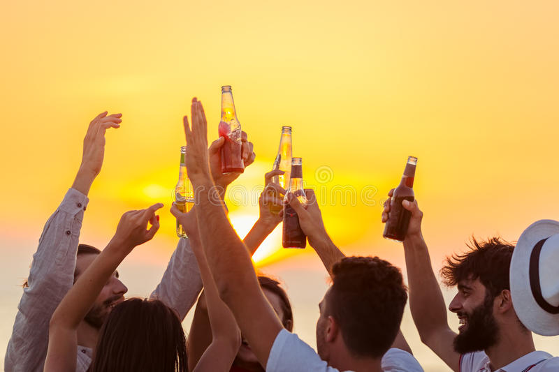 Friends Beach Party Drinks Toast Celebration Concept.  royalty free stock image