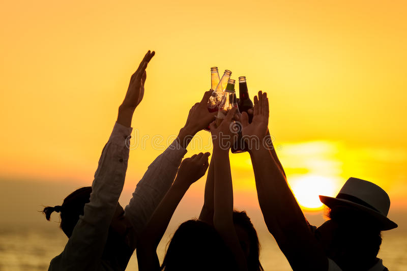 Friends Beach Party Drinks Toast Celebration Concept.  royalty free stock photo