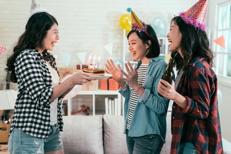 Friends birthday singing song and clapping hands. Girl best friends birthday party at home singing songs and clapping hands. young ladies giving surprise in the stock photo