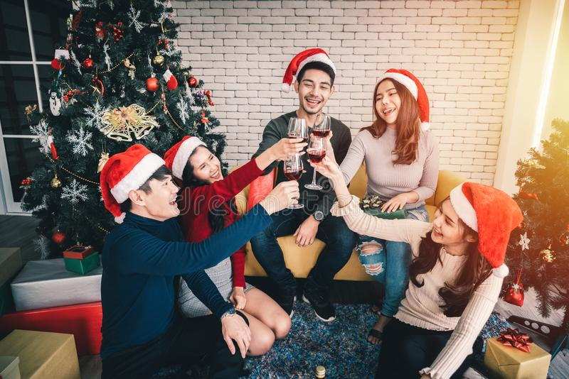 Friends both man and woman or young people are gathering for Christmas and New Year holiday stock image