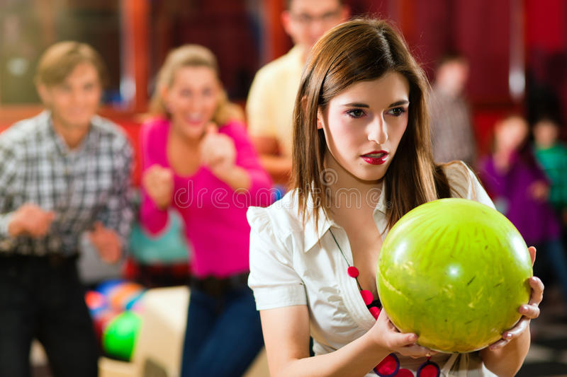 Friends bowling having fun stock images