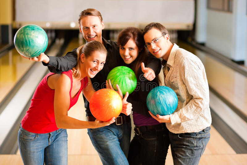 Friends bowling together royalty free stock photo