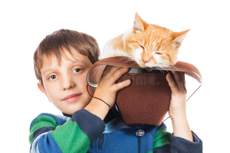 Friends. Boy and his darling red cat in hat. Isolated on white stock image