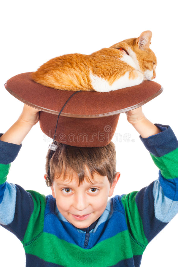 Friends. Boy and his lazy red cat in hat. Isolated on white stock photo