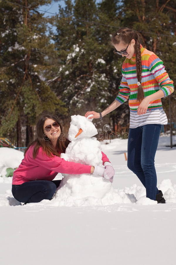 Download Friends Building Snowman Stock Image - Image: 19376701