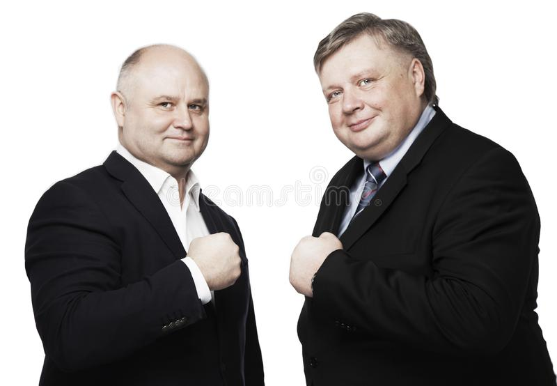 Friends businessmen smiling, close-up royalty free stock image