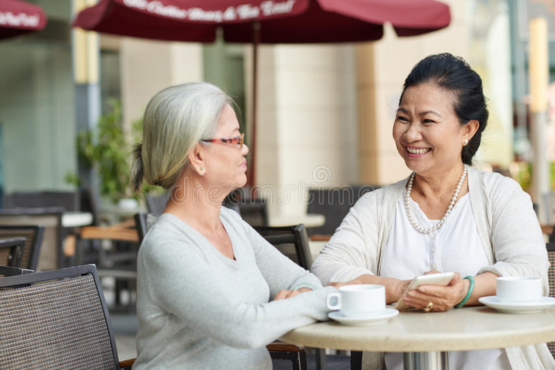Friends in cafe royalty free stock photo