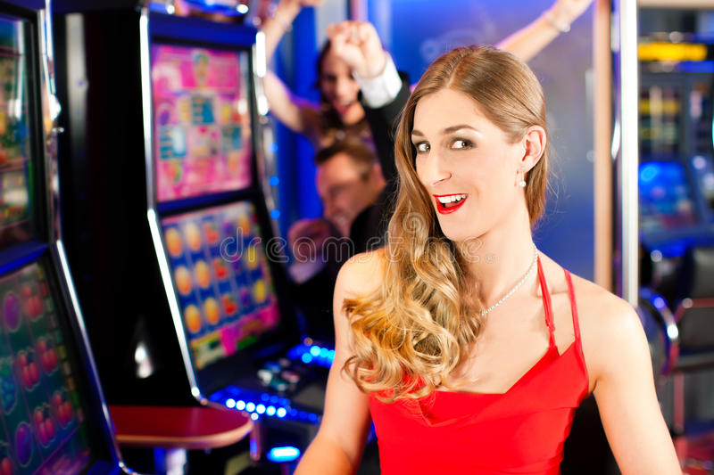 Download Friends in Casino stock image. Image of suit, games, automat - 19324413