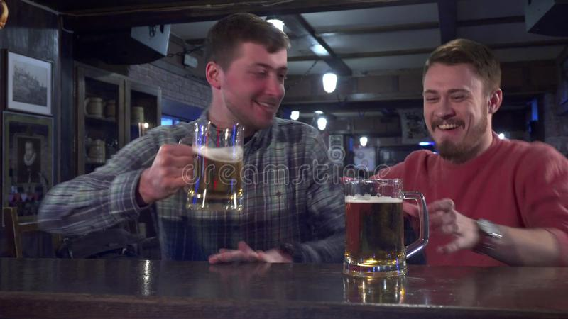 Friends celebrate success of their team at the pub royalty free stock photography