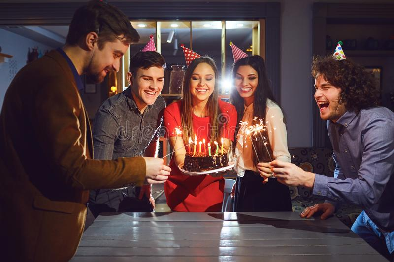 Friends celebrating birthday party indoors royalty free stock photos