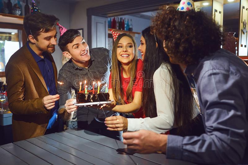 Friends celebrating birthday party indoors stock images