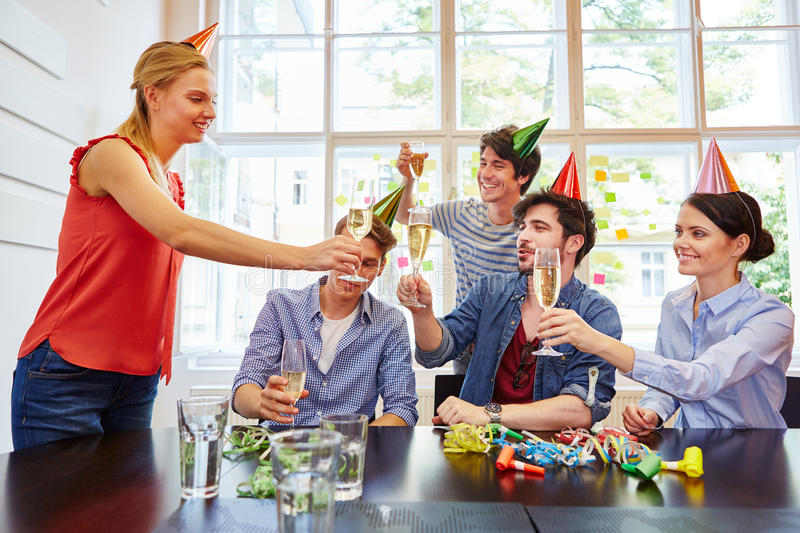 Friends celebrating with champagne royalty free stock photography