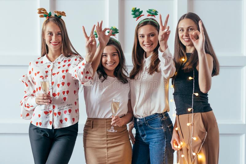 Friends celebrating Christmas or New Year eve party showing gestures 2020. stock photography