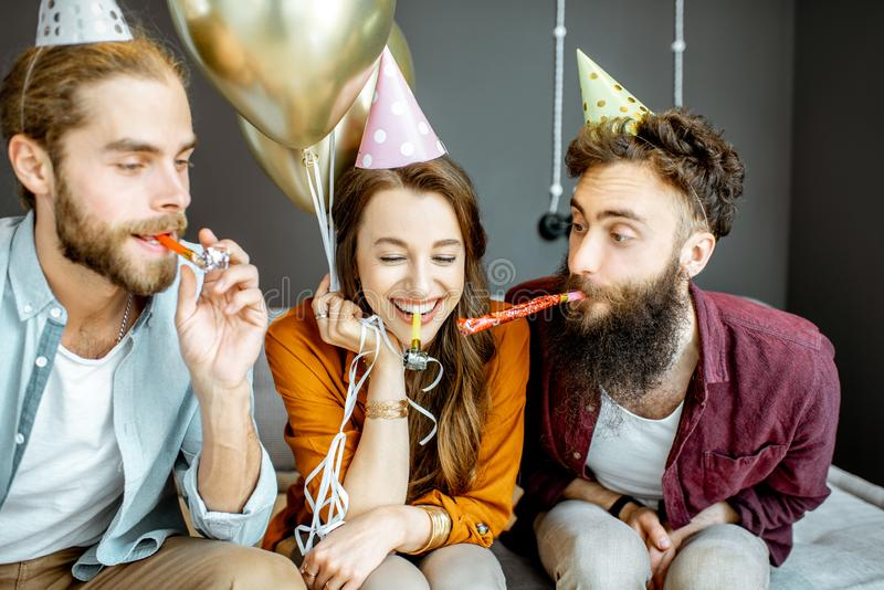 Friends celebrating at home stock photos