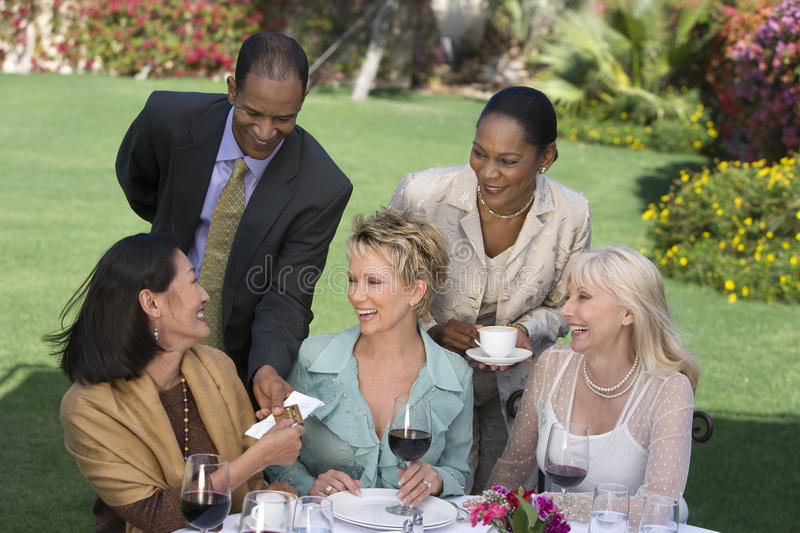 Friends Celebrating Together With Wine stock photo