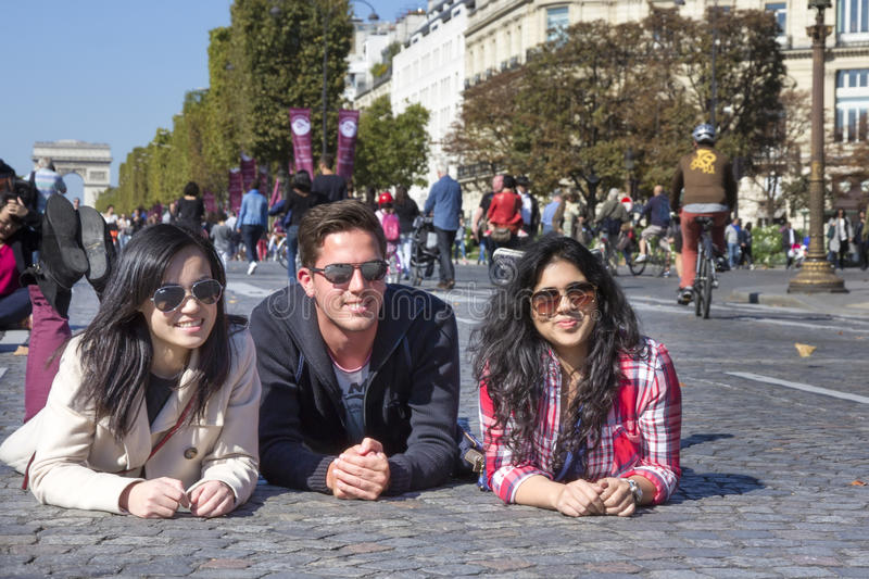 Friends on Champs Elysees at Paris car free day stock images