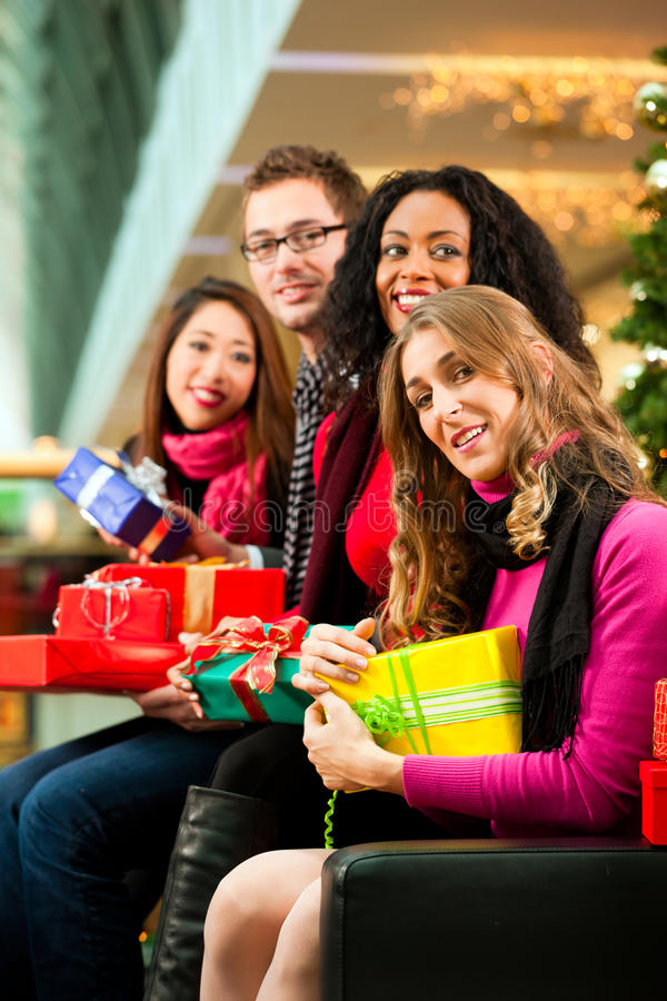 Download Friends Christmas Shopping With Presents In Mall Stock Photo - Image: 17246828