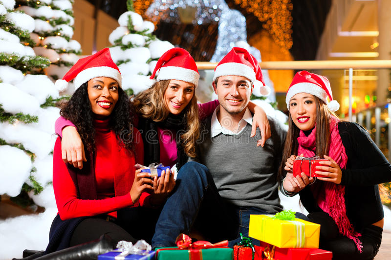Friends Christmas Shopping With Presents In Mall Royalty Free Stock Image