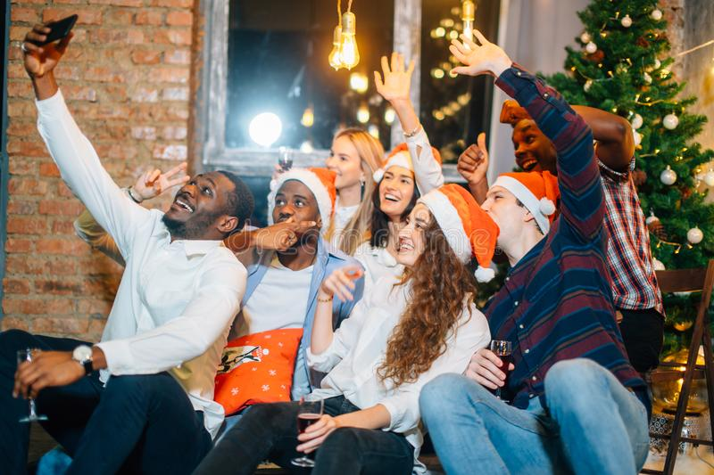 Friends at club making selfie and having fun. Christmas and New year concept stock image