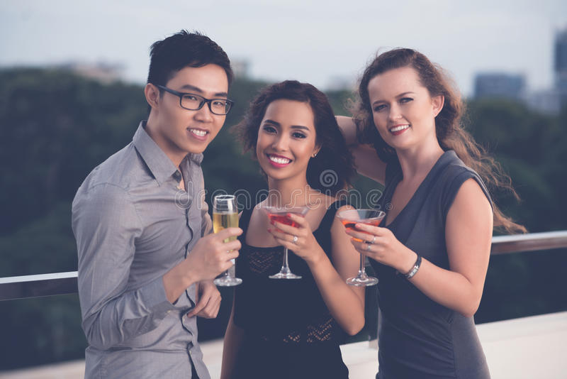 Friends with cocktails stock image