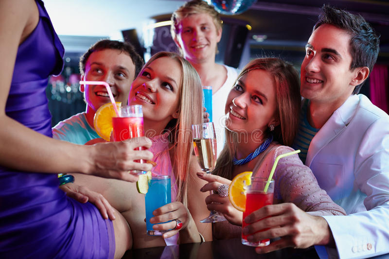 Friends with cocktails stock photography