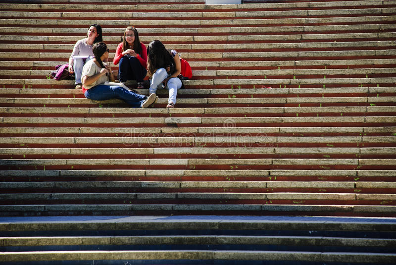 Friends. Concepcion, Chile. Study group of friends sitting on the steps of the University of Concepcion