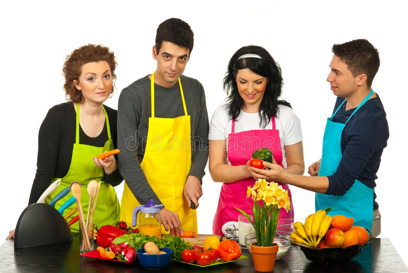 Friends cooking together stock image