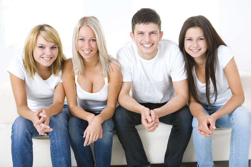 Friends on a couch stock images